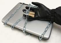 image of laptop secured by chain and padlock