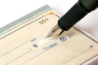 image of pen writing a check
