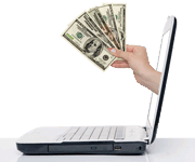 hand with cash coming out laptop